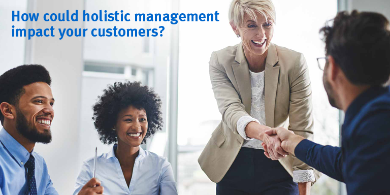 Holistic management impacting customers in a meeting.